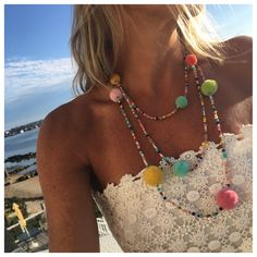 I Just cant ever pass on a good Pom Pom necklace and when I came across this one I HAD to get it Made0 Now offered By Pink Pineapple for just $38 this beauty is so long you can wrap it three times. Yo