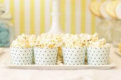 snacks in polka dotted paper cups
