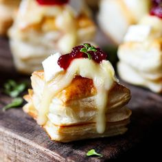 Cranberry and Brie bites - a simple appetizer or party snack that always gets polished off in minutes! Ready in 20 minutes!