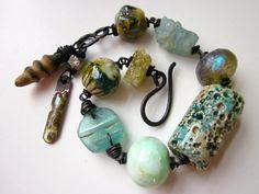 Something Nebulous -primitive assemblage aqua art bead, Basha bead, Roman glass, aquamarine, chrysoprase, & copper charm bracelet by LoveRoot, $80.00