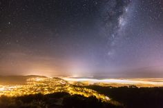 The Milky Way rises above a foggy Wellington.