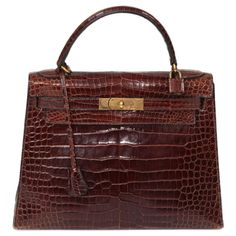 1961 - 1962 Hermes Kelly 29 cm Baby Crocodile Bag   From a collection of rare vintage handbags and purses at http://www.1stdibs.com/fashion/accessories/handbags-purses/
