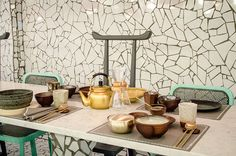 Paola Navona, A small korean restaurant is rendered in a mosaic of glossy fragments of tile complemented by a series of colorful unique fixtures and furniture.
