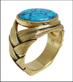 This ring by Chris Keenan is set with a turquoise cabochon.
