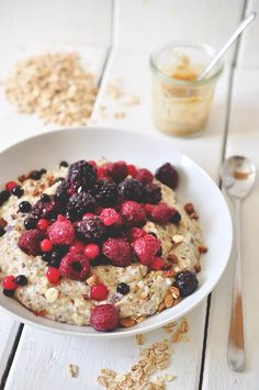 fluffy oatmeal with berries and peanut butter drizzled on top | nads healthy kitchen
