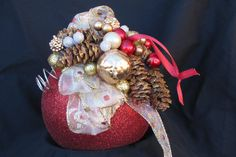 Large red glittery ornament decorated for Christmas
