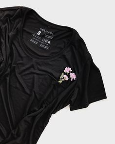 This light-and-airy, semi-sheerpocket t-shirt is a versatile essential. It fits a little looser for that perfect relaxedlook. The way it the soft fabric drapes is super flattering. Style it tucked into your go-to cut off jean shorts. Throw on your favorite converse sneakers, a fun, summery choker, and this black dad cap with an encouraging reminder for you and everyone you see!