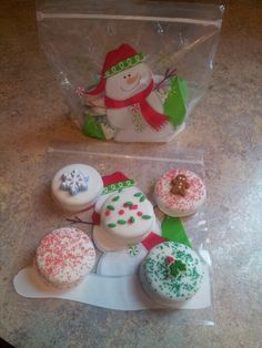 Oreos dipped in melted vanilla candy coating, t decorated and wrapped in a cute bag...easy, inexpensive gift!! Kids and adults love them!!!