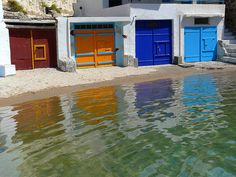 Boat garages, Milos island discovered by bell the cat Planet Earth 2, Bell The Cat, Boat Garage, Greece Art, Old Doors, Greek Islands, Garages, Ocean Beach, Art And Architecture