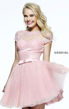 "Dress length: 17"" (Waist to hem) Shown in: Blush Be gracious with Sherri Hill 21231. The gown features a rounded neckline and a cap sleeves. The bodice is embellished with beads to enhance the look of this creation. The pleated skirt effortlessly sways as"
