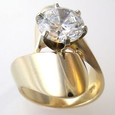 Stunning on a long, slender finger. Shown with a 3ct. fine quality CZ. I can set this with a range of sizes of stone. This ring is equally