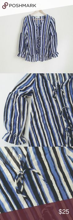 """NWT blue stripe swing shirt long-sleeve bow ties NWT top. Blue, black and ivory watercolor-brush stripes. Slight hi-low swing style. V-neck. Three front bow ties. 100%poly. Light and flowy. Size S, loose fit. chest 17"""", length 23""""/27"""". 🚫no trade Tops Blouses"""