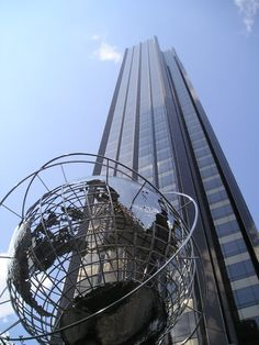 """PACE designed the landmark """"globe"""" sculpture in front of the Trump building, which as become an iconic Manhattan monument and popular Central Park attraction!"""