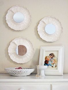 This is an awesome idea for using beautiful, unique plates you might inherit, find or salvage. We've seen scads of beautiful wall-mounted plate displays, but stick a round mirror in the center and it becomes something different altogether.