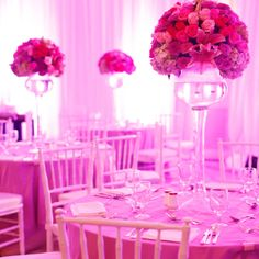 High pink centrepieces sit on the reception tables