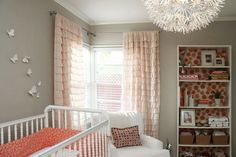 l love the idea of putting fabric or wallpaper in the back of a bookcase and the ruffled curtains...so sweet!
