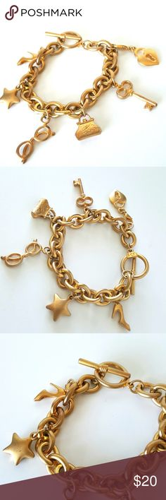 """Victoria's Secret Goldtone Charm Bracelet Very good to excellent pre-owned condition. 8"""" long. Futs small to medium wrist. Goldtone construction. Please review all photographs as a part of the description. Victoria's Secret Jewelry Bracelets"""