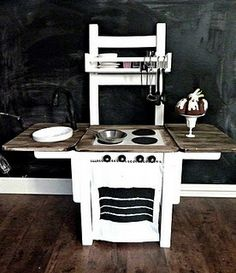 Chair into play kitchen - neat. If you made the sides so they fold down, this would be great for a small space.