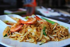 Pad thai (or phad thai) is a typical street food of Thailand and a ubiquitous dish on Thai-American menus as well. This authentic pad thai recipe (made gluten-free) comes from the Chiang Mai Cookery School located in the Northern mountainous part of Thail Thai Street Food, Best Street Food, Phad Thai, Shrimp Pad Thai, Shrimp Soup, Authentic Thai Food, Thai Noodles, Rice Noodles, Thai Dishes