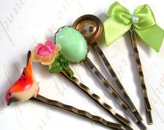 Vintage Hair Bobby Pins - Gorgeous Hair Bobby Pins Sweet Vintage Collection  Set  Of Five.  Set of five ..Handmade Bow with pearl In Light Green, hand drawn red winged bird, light green cabochon, and a hand painted rose with a yellow and pink flower and a green leaves and a vintage brass button, glued on antique bronze tone hair bobby pins.  This will make a gorgeous accessory for your beautiful hair!