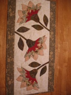 same flower table runner quilt different color placement