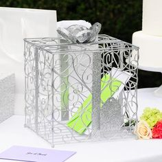 Keep your wedding cards and well wishes wrapped in style with this unique silver gift box wishing well.