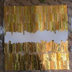 Making art. Forming the collage from new and recycled confectionery and chocolate wrappers. Made from golden wrapper plamil dairy  free, temple organic, trebor lemon softmints, after eight #qualitystreetUK #rolo #nestleUK #FerreroUK #audreyschocs #plamilfoods #trebor  #tesco #foil #foils #art #artwork #artist #collage #contemporary #contemporaryart #contemporarycollage #modern #modernart #moderncollage #abstract #abstractart #abstractcollage #loutheartist1
