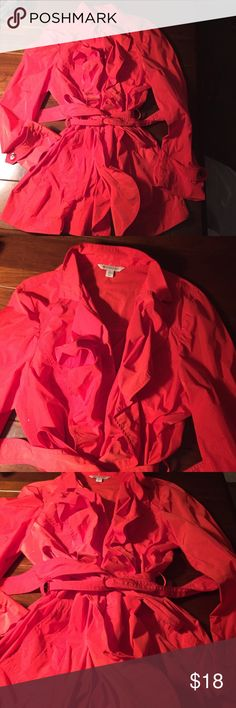 Spanner** red jacket Lady on red. Stylish with belt. Pockets in from. Ruffling on top half on front of jacket. That's why it looks flattering Spanner Jackets & Coats