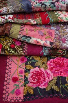 handmade quilt with vintage fabrics, dyed blankets, tweeds and hand embroidery