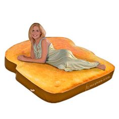 """inflatabletoast mattress  """"This piece of toast is made of plastic, not bread, so if you wake up and smell burning toast, you are probably just having a stroke."""""""