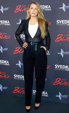 BLAKE LIVELY wearing a black leopard stretch-tulle bodysuit with a white ribbed tank, black pleated wool-serge trousers and a Vachetta leather belt, all from the Fall 2017 Michael Kors Collection, which she paired with matching black pumps at the Paint It Black premiere in New York City.