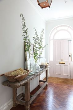 large glass vases in entrance