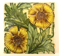 A William DeMorgan tile decorated with twin yellow petal floral sprays #tiles #ukauctioneers #adampartridge