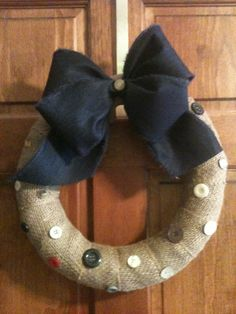 Small wreath made with burlap, lightweight denim ribbon and buttons I have had on hand for awhile.