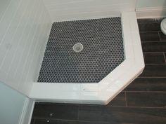 Shower floor ideas- black hexagon tile with white grout.  Shower walls white subway tile.