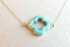 Turquoise clover framed in 24k gold necklace