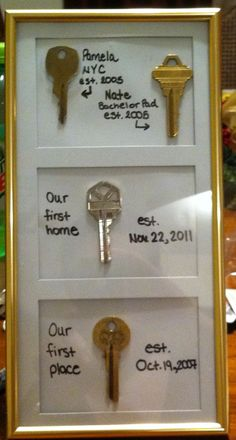 A shadow box with a copy of our first place key cute