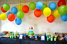 Love the balloons - provides tons of color! Maybe can make for above the food or above the game systems?