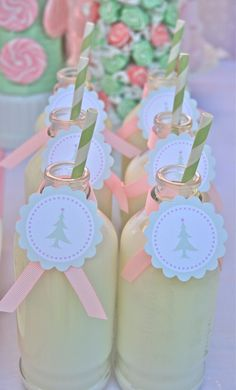 Decorated milk bottles at a pastel Christmas party #milkbottles #christmasparty