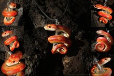 Strawberry Motley Corn Snake Necklace by *IllusionTree on deviantART. Love this artist's reptile necklaces. They are gorgeous, the only thing I would change is what they are wrapped around. I am not in love with the clear crystal, I liked the blue and  black ones, but my favorites would probably be marbles, if she did them.