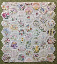 "Finished! Overall measurements are 36.5"" x 40.5"". There are 46 full hexagons measuring 6.5"" point to point and 6 half hexagons. I started this project in May 26, 2014, finished it July 4, 2015. By Rhonda Dort"