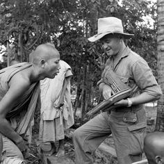 """During the operation """"Karamako"""" near the Giang-Thanh river, Lieutenant Ziegler at the 6th Colonial Infantry Regiment speaks with the chief of a pagoda. Pin by Paolo Marzioli"""