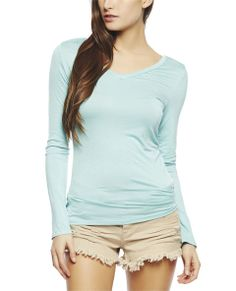"This top is great piece to transition into next season!  It features a    solid knit body, v-neck, long sleeves, and a relaxed fit.   Model is 5'9"" and wears a size small      95% Rayon / 5% Spandex      Machine Wash     Imported"