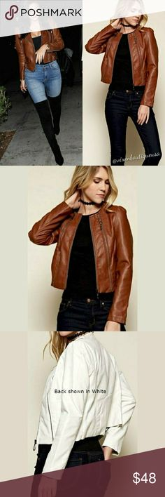 Celeb Inspired Vegan Leather Cropped Moto Jacket This timeless edgy and chic cropped vegan leather jacket is a must have wardrobe essential. Style over an LBD for a night on the town or throw over your favorite tee and jeans and some killer heels and you're golden. Go Soho style and dress up a pair of?sweats!  FEATURES:  - Long sleeves - Three?zipper front - 50% Ctn?  40% PU?  10%?Polyester - Dry Clean? - Runs true to size?  **Celeb pic(s) are for inspiration/comparison only. Actual item is…