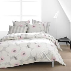 Marimekko Unikko / Korsi Percale Bedding: Pale hues of pink and grey give Maija Isola's famous 1964 poppies an almost ethereal feel, perfect for whisking you away to dreamland.