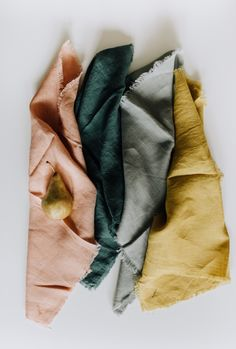 Soft linen napkins go with a meal of backyard tomatoes and basil tossed with fresh pasta and grated parmesan. Made of pure, natural linen in a solid hue, these napkins have a frayed edge and a hand-se