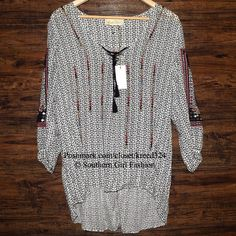 """FREE PEOPLE Tunic Love Sam Embroidered Lace Up Top Size XS New With Tags $148.00  *By Love Sam for Free People  Gauzy patterned tunic, featuring a lace-up neckline, 3/4 sleeves and Hi-Lo hem.  *100% Viscose Measurements For Size XS: Bust: 42"""" Length (front): 23"""" Length (back): 28""""  Sleeve Length: 17""""   ❗️ Please - no trades, PP, holds, or Modeling.   ✔️ Reasonable offers considered when submitted using the blue """"offer"""" button.    Bundle 2+ items for a 20% discount!    Stop by my closet for…"""