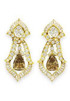 Elizabeth Taylor Jewelry: Sold!  Van Cleef & Arpels Burton Cognac Diamond Earrings, from Christie's sale of Elizabeth Taylor's jewels  via InStyle.com