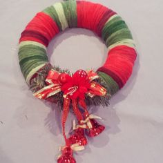 Wool wrapped polystyrene wreath with Christmas decoration