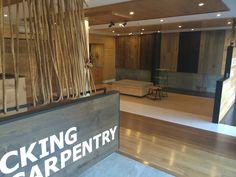 No12 Trading - Design Team - Jet Dry concrete flooring to the foyer area, with bamboo flooring and oak flooring and paulownia timber panelling from the Style Plantation range to showcase the company's range - Style Plantation Sydney Showroom